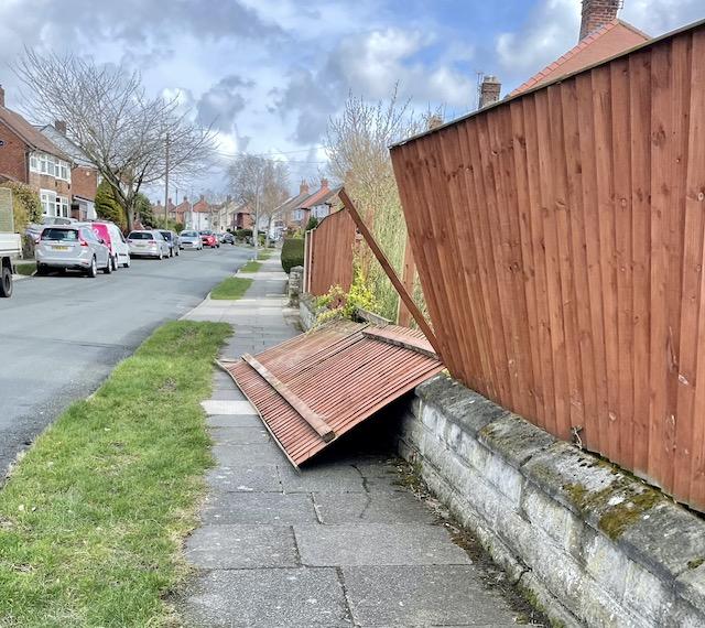 A fence panel fallen down