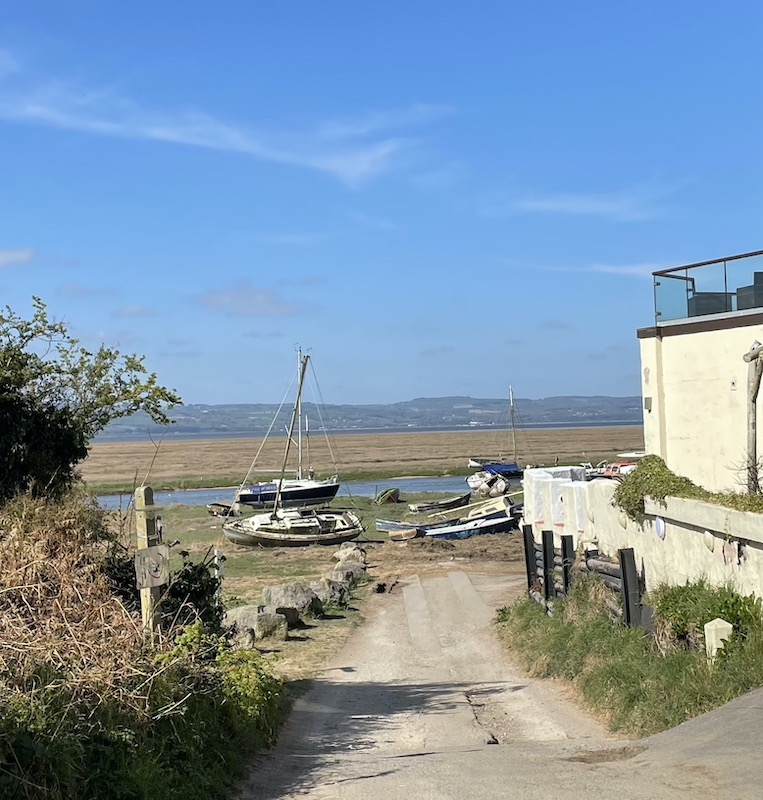 Sheldrakes, the final low point, with derelict boats in the near ground.