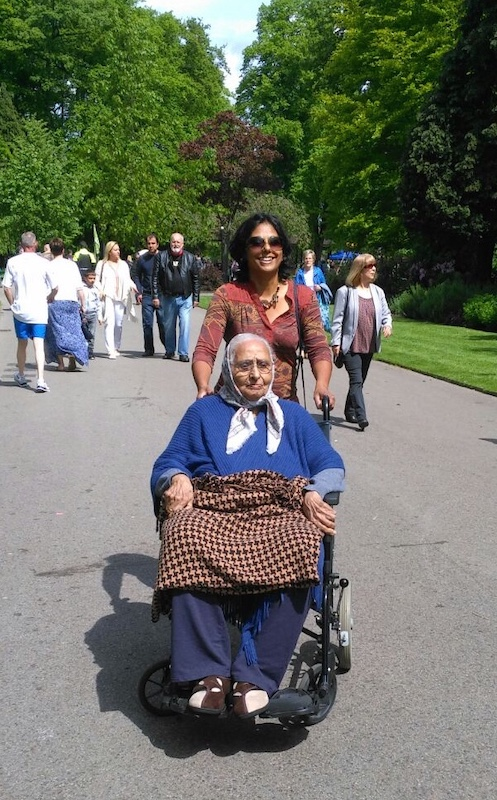 Me wheeling my grandma about in the park in her wheelchair