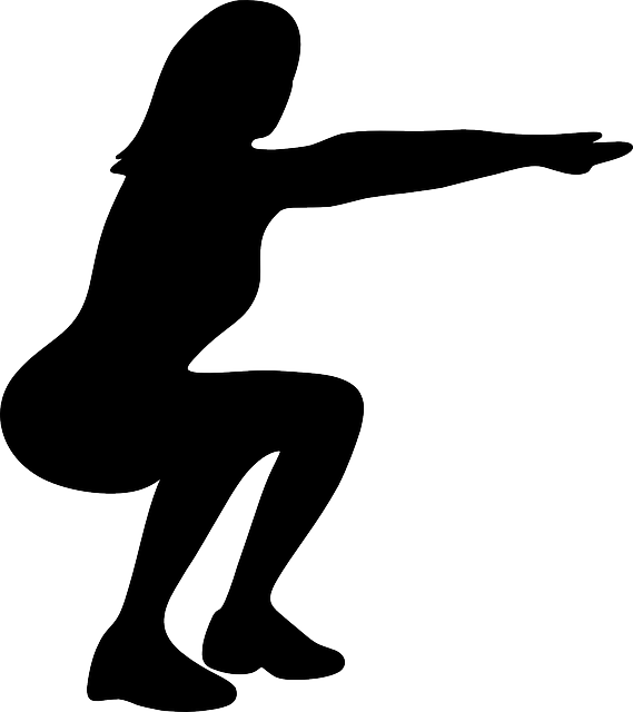 Silhouette of a woman doing a squat