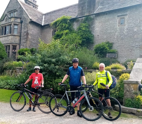 Us three cyclists in front of Hartington Hall Youth Hostel