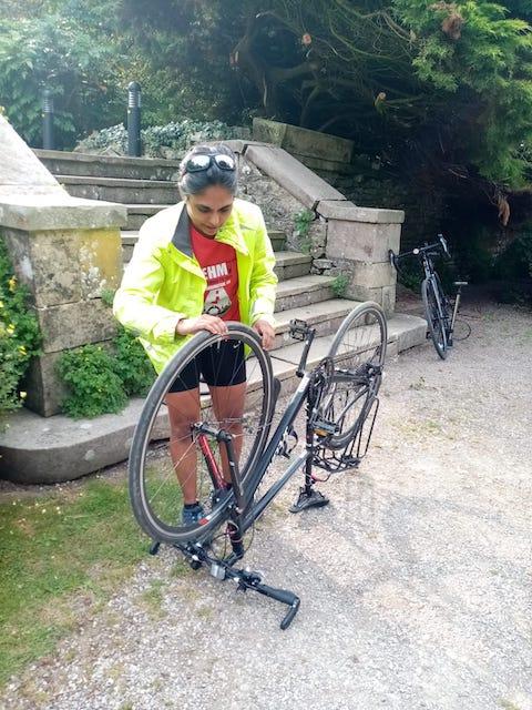 Me inspecting my bike wheel